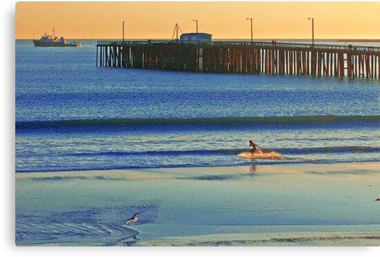 Surfer, Avila beach California. by Eyal Nahmias