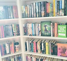 bookshelves with books by Maggie Wilson