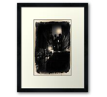 Dark alley with water tower in New York City at night Framed Print