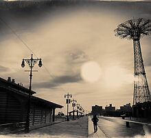 A man walking along the Coney Island boardwalk at sunset with the Parachute Jump in a sepia - colored postcard by Reinvention