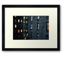 A New York City courtyard with lit windows at dusk  Framed Print