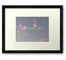under the same sky. Framed Print