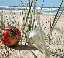 Two Christmas Baubles On The Beach by Celeste Brignac