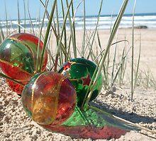 Three Christmas Baubles on the Beach by Celeste Brignac