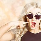 Surprised blonde woman with retro hair and makeup by Ryan Jorgensen