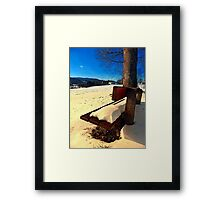 Snow covered bench in winter scenery | landscape photography Framed Print