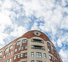 Curved Building Under Brilliant Skies by dbvirago