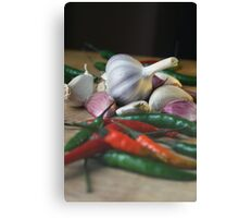 Garlic and chillies Canvas Print