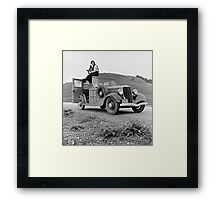 Dorothea Lange atop automobile in California. The car is a 1933 Ford Model C, 4 door Wagon. Framed Print