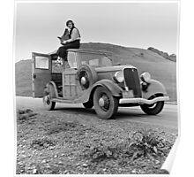 Dorothea Lange atop automobile in California. The car is a 1933 Ford Model C, 4 door Wagon. Poster