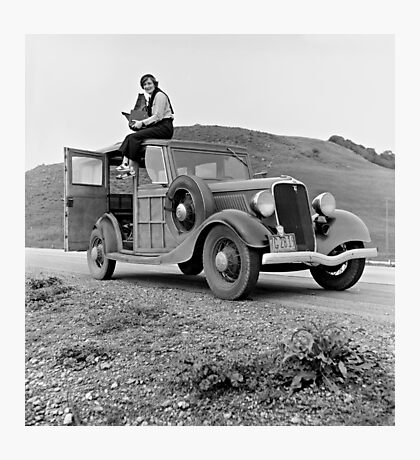 Dorothea Lange atop automobile in California. The car is a 1933 Ford Model C, 4 door Wagon. Photographic Print