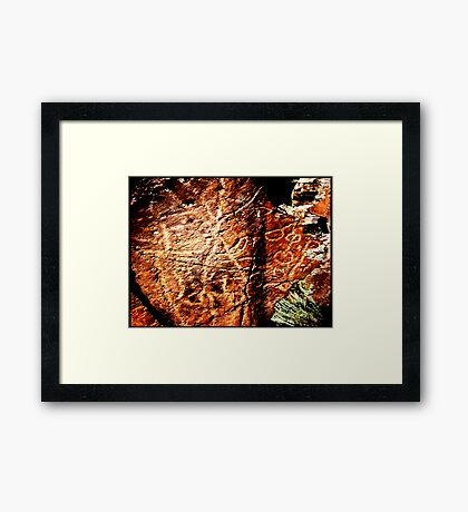 Pictographs or rock scratches Framed Print