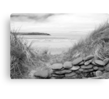stone wall shelter on a beautiful beach in black and white Canvas Print