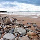 storm clouds over rocky beal beach by morrbyte