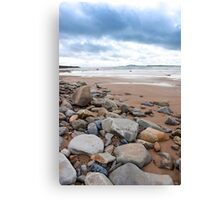 storm clouds over rocky beal beach Canvas Print