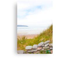 stone wall shelter on a beautiful beach Canvas Print