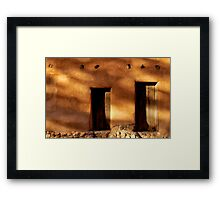 Two wooden doors on an adobe building in Santa Fe New Mexico Framed Print