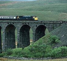 Carlisle Settle train about to leave Ribblehead Viaduct North Yorkshire England 198406010010 by Fred Mitchell