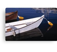 Boats docked on calm water Canvas Print