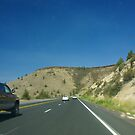 Traffic blur - highway through Central Oregon volcanic landscape by cascoly