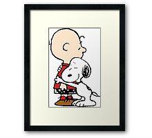 Charlie hugs Snoopy Framed Print