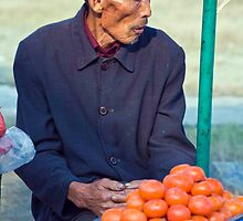 Hollow Cheeked Tomato Vendor by phil decocco