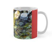 Stream rushes over pebbles Mug