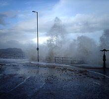 Breaking waves at Colwyn Bay  by Ian Richardson