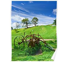 Old agricultural machinery in a field Poster