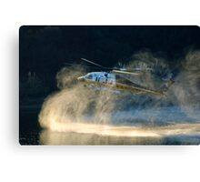 Fully loaded. L.A. County fire helicopter fill water at Lauro Reservoir in Santa Barbara, CA in an effort to extinquish the Tea Fire Canvas Print