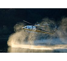 Fully loaded. L.A. County fire helicopter fill water at Lauro Reservoir in Santa Barbara, CA in an effort to extinquish the Tea Fire Photographic Print