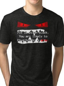 It is pitch black. You are likely to be eaten by a grue. Tri-blend T-Shirt