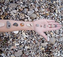 beach stones on an arm by Nicole M. Spaulding