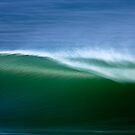 Green Wave Against Blue Water by David Orias
