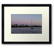 Boat patiently waits on the lake Framed Print
