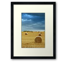 Hay Bales in Field with Stormy Sky Framed Print