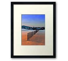 Fences, evening sun and the village | landscape photography Framed Print