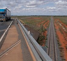 Diverging lines in the outback by Syd Winer