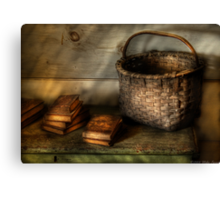 A Basket and some Books Canvas Print