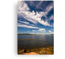 Winter Harbor Lighthouse under a Blue Sky and White Clouds Canvas Print