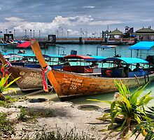 Longtails at Phi Phi harbour by Robyn Lakeman