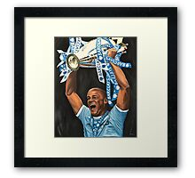 Vincent Kompany lifting Barclays trophy Framed Print