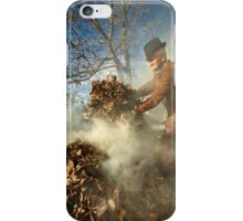 Old farmer burning dead leaves iPhone Case/Skin