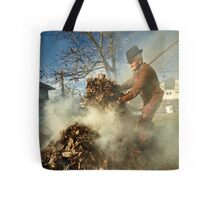 Old farmer burning dead leaves Tote Bag