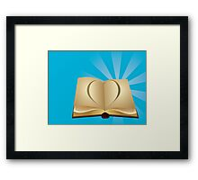 Heart cut out of book Framed Print