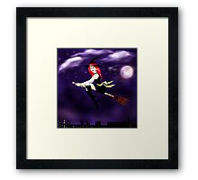 Witch on a broomstick flying in the night Framed Print