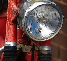 Red headlight by Norman Repacholi