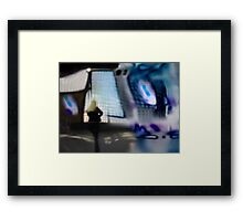 Blond woman looking through window Framed Print
