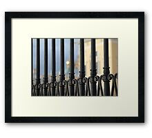 Sun behind the fence Framed Print