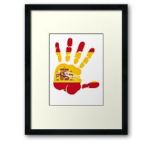 Spain flag in handprint Framed Print